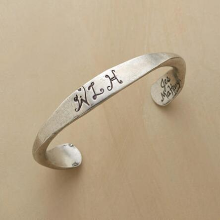 A men's personalized pewter cuff bracelet with appealing sheen and fine lettering.
