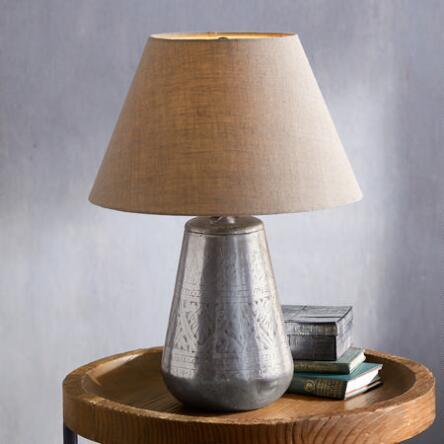 A lovely artisan design adorns the elegant base of this hand etched silverplated table lamp