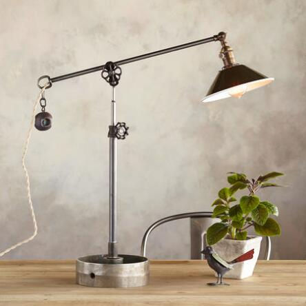 Robert ogdens creative cheyenne table lamp boasts a unique industrial