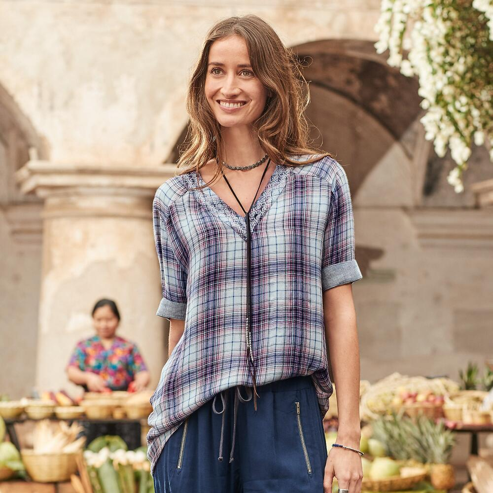 This 'Roberta' V-neck tunic brings out the pretty in plaid with embroidered