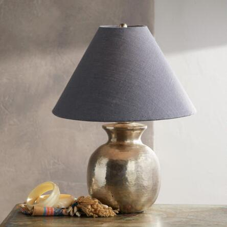 The antique silver finish on our olivier hammered brass and iron lamp adds vintage